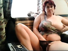 Busty aged dark brown shows her titties and fingers her pussy