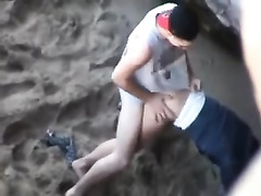 This doxy is definitely having a great time with her BF on the beach