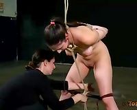 Lengthy haired black brown minx bounded with ropes and punished