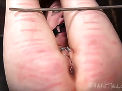 Perverted redhead wench is brutally beaten by her slaver