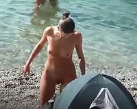 Perfect bare bronze skin a-hole on the nudist beach sunbathing