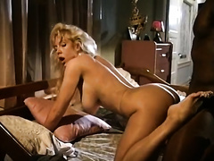 Brazen hussy with large billibongs is getting fucked doggy style in hardcore interracial porn episode