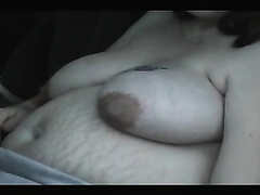 My busty preggy cheating wife smokes in a car and kneads her mambos