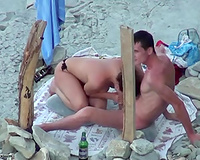 Brunette white bitch blows her boyfriend on the nudist beach