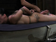 Bodacious babe is hogtied on the couch for castigation