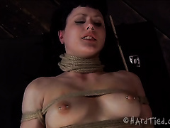 Sexy dark brown slave sweetie with pins on her body tortured by a mastix
