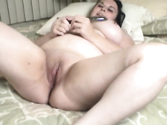 Hefty tattooed brunette hair smashes her twat with a sex-toy