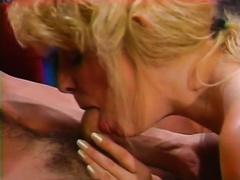 Busty blond secretary pleases her boss on the office desk