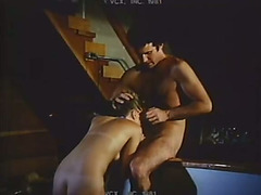 Brown-haired babe allows a stud to face-fuck her in retro sex movie