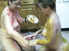 Nerdy dilettante skanks smear each other's bodies with food in the kitchen