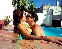 Kissing my fresh sexy girlfriend in the sweeming pool