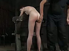 Slim redhead hottie is punished by her perverted master