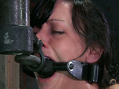 Perverted servitude dominant stimulates his slave's snatch with vibrator