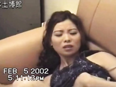 Shameless Chinese hussy widens her legs wide and begins masturbating