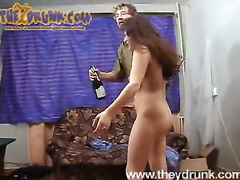 Two brunettes scissor and show their oral skills