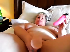 SSBBW white granny slutty wife playing with a pair of dildos