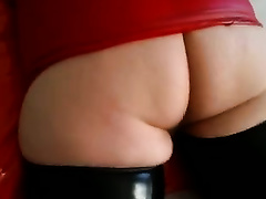 Chubby white cheating wife lies on her abdomen in hot latex outfit