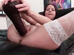 Slim nympho in white nylons likes to fuck herself with her chocolate marital-device