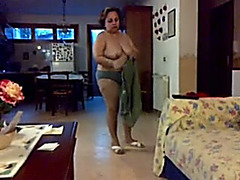 Chubby aged black cock slut changes her clothing in front of a camera