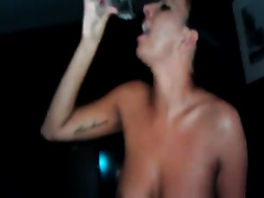 She spits all the cum deposit in the glass and savors it like juice