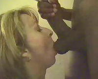 Amateur blond mother I'd like to fuck blowing a dark wang