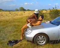 Interracial pair copulates outdoors in the car