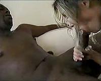 Babe takes on a big dark pecker