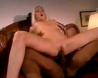 Pretty blond chick takes on a dark weenie