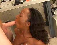 Black woman sucks large knob