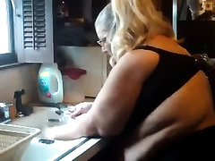 Shooting my plump queen washing dishes in kitchen