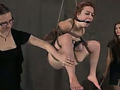 Bounded redhead babe with great skinny body is suspended and punished
