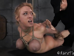 Sexy blond mama is hogtied and dominated by an older taskmaster
