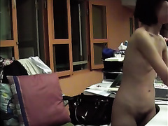 Petite Asian office girl undresses and demonstrates her body