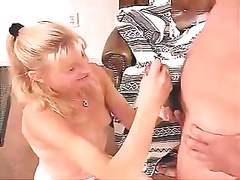 She is on her knees jerking off the jock of the college lad