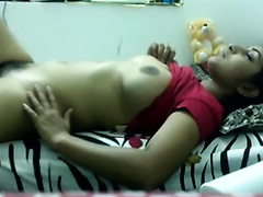 Busty Indian black cock sluts masturbates her bushy snatch with red thing