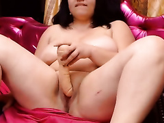 Obese web camera bitch with saggy scoops is playing with herself