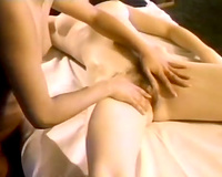 Playful lesbian babes are having joy in 69 position in the massage parlor