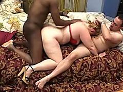 Plump blond doxy enjoys interracial team fuck indoors