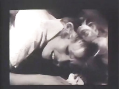 Slutty woman acquires drilled by masked chaps in retro movie scene