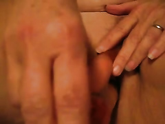 My older wifey entertains herself by toying her coochie