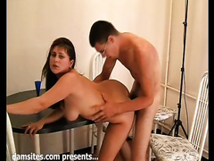 Busty college white women lies on the table and widens her legs