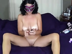 Masked slutwife with saggy milk cans is masturbating for me