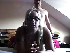 Amazing blond smoking and fucking in her bedroom