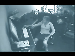 Hidden cam catches a secretary masturbating in an office