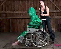 Lascivious nympho is placed into a wheeled restraint chair