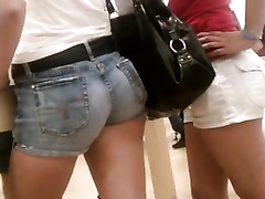 A pair of hawt non-professional chicks with marvelous butts in public
