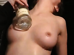 Masturbating with a bottle and high heel shoes on the table