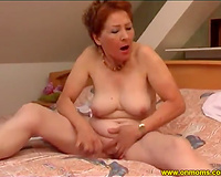 Horny aged bitch with miniature mambos copulates herself with a glass fake penis