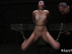 Horny servitude master stimulates his slave's vagina with vibrator