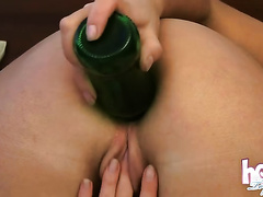 Wanton brunette whore inserts green bottle in her constricted ass hole
